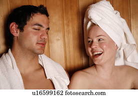 Couple Sitting In A Sauna With Panoramic Window High-Res