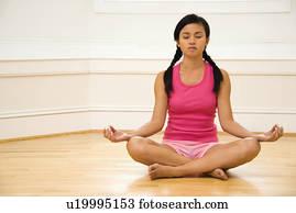 woman sitting on floor legs crossed eyes closed stock