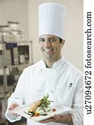 Chef presenting gourmet entree