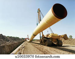 Positioning flexible steel pipes using crane.